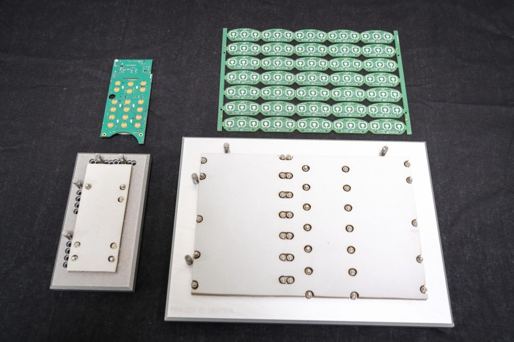 placement fixture for securing dome to the circuit board